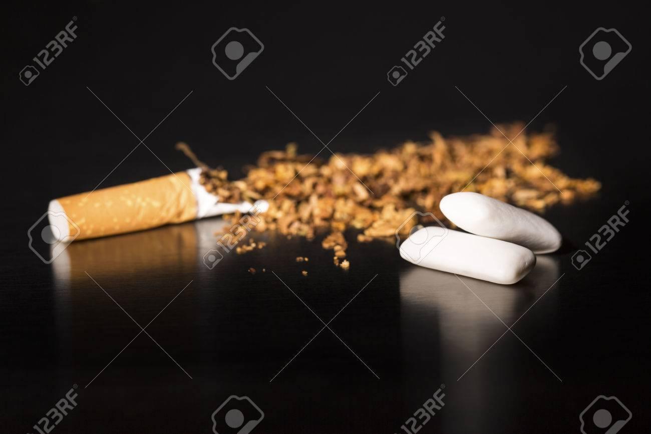 Broken cigarette on black background, reflected, stop smoking,