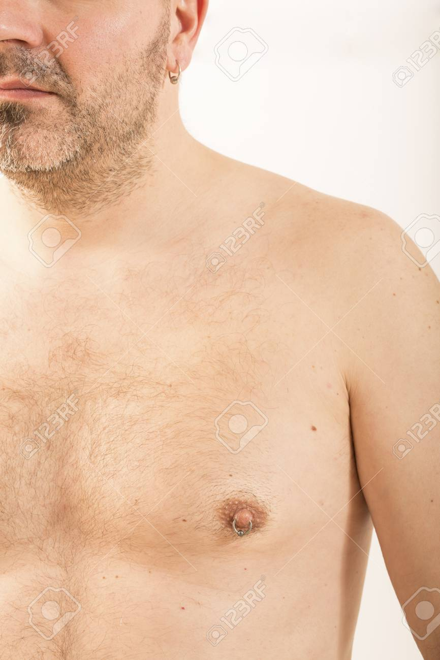 Close Up Of Muscular Male Torso With A Nipple Piercing Stock Photo