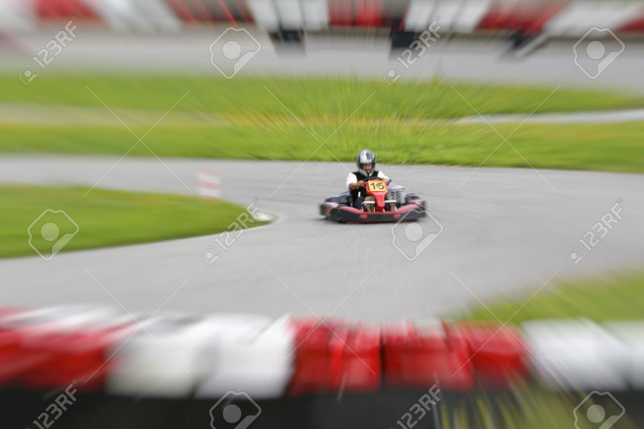 go-kart pilot is racing a race in an outdoor go karting circuit