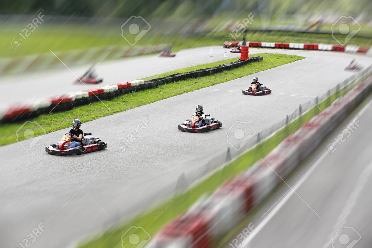 go-kart pilot is racing a race in an outdoor go karting circuit