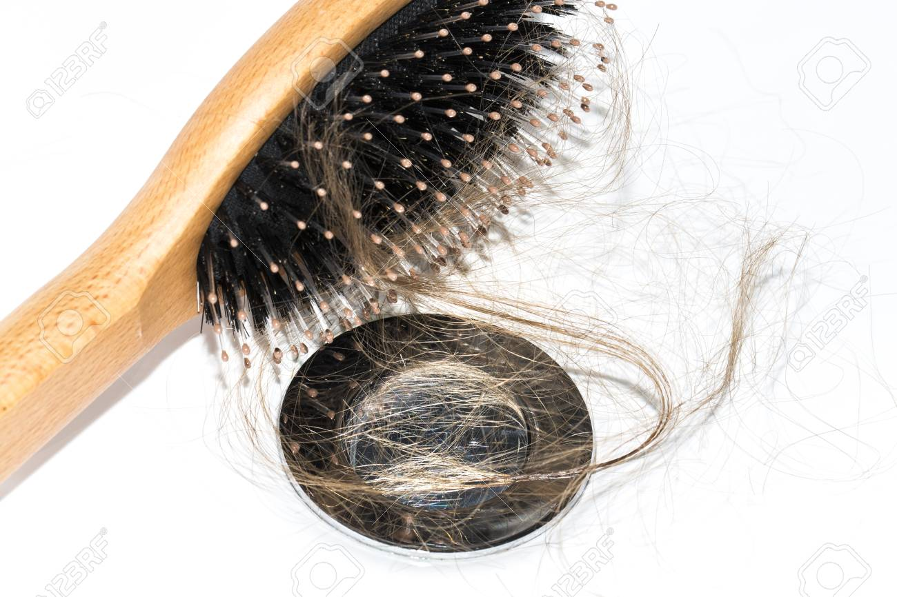 Hair Loss On Washbasin Long Brown Hair With Wood Brush On White
