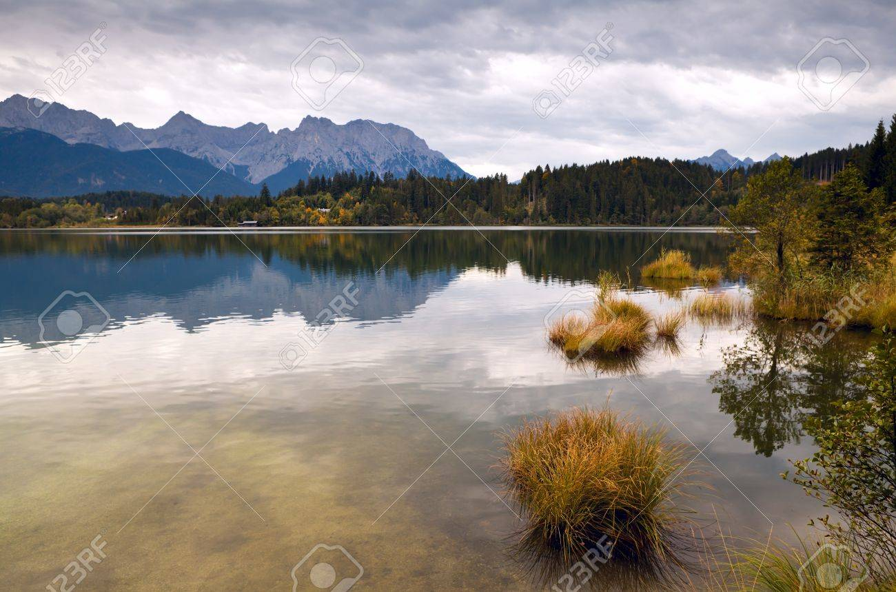 calm clouded landscape with wild lake Barmsee and mountains in Bavarian Alps Stock Photo - 15809412