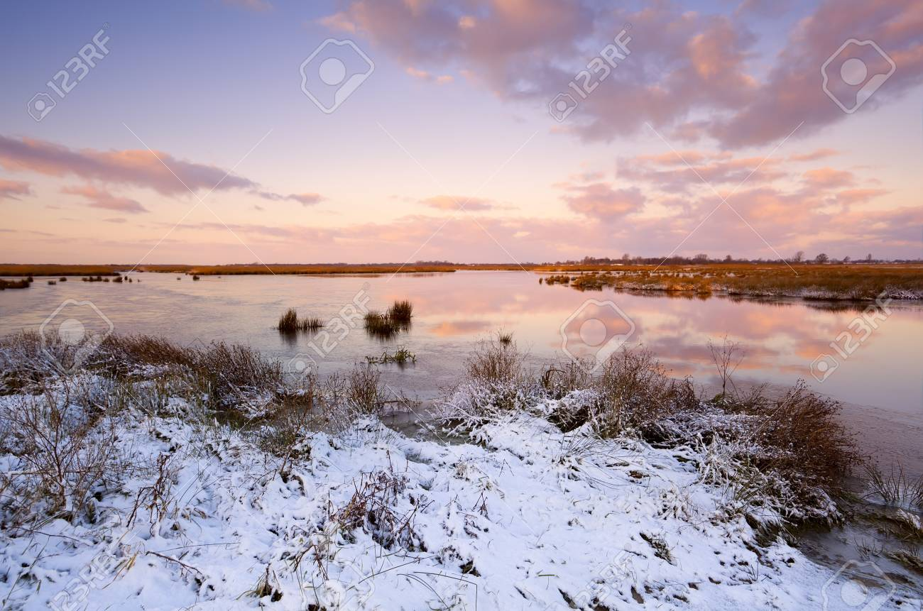 sunrise over frozen lake at winter Stock Photo - 16892146
