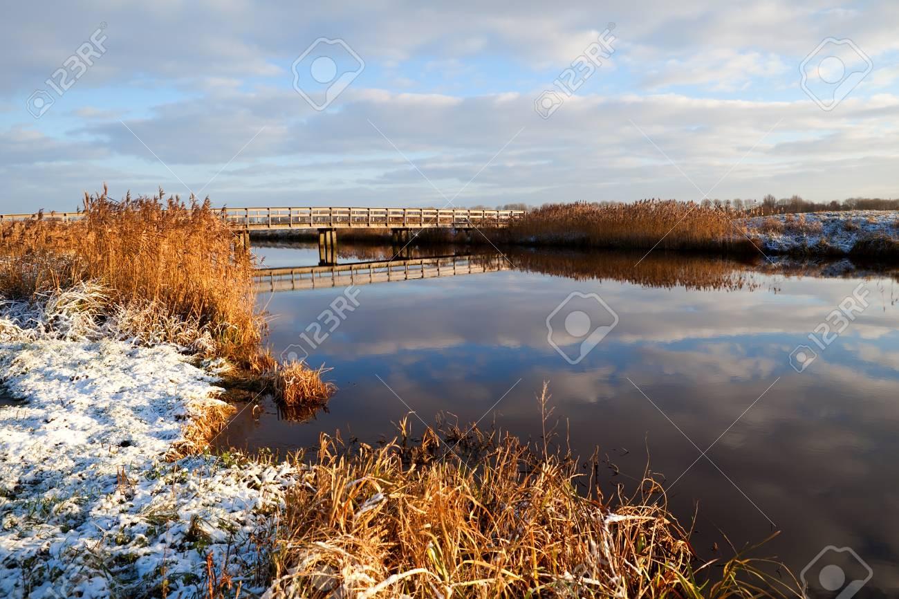 wooden bridge over river in winter Stock Photo - 17308830
