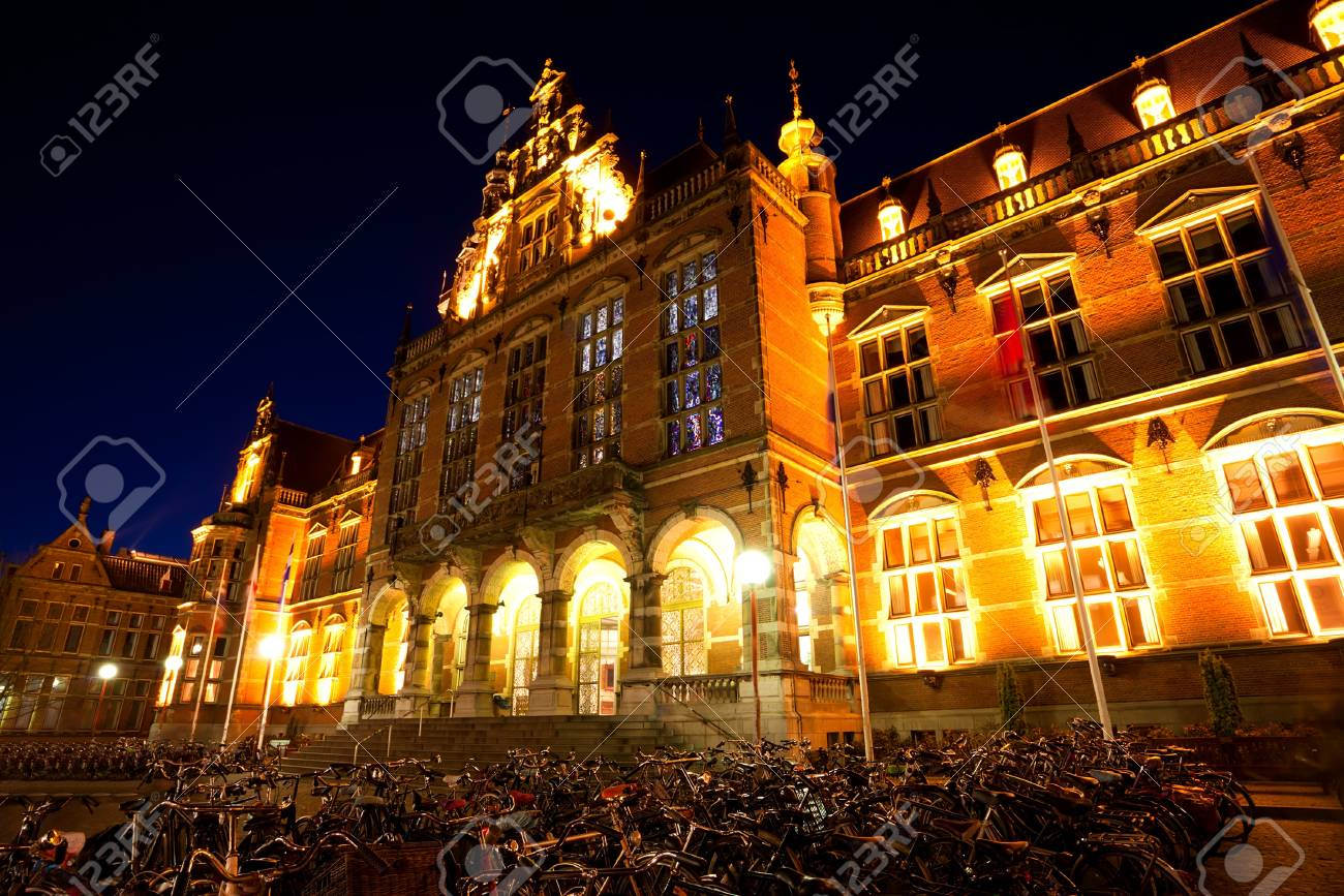 bicycles parking by University of Groningen at night, Netherlands Stock Photo - 18978329