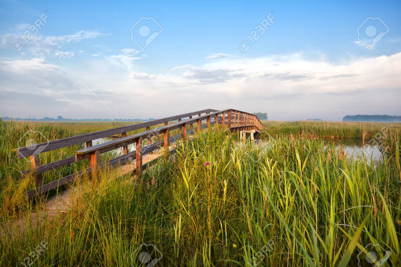wooden bridge over river for bikes in the morning, Drenthe, Netherlands Stock Photo - 20667696