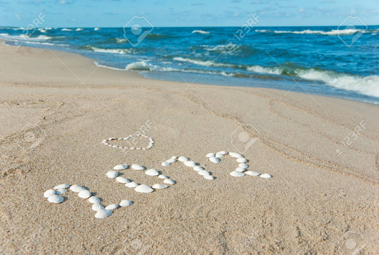 year 2012 written on sand with seashells Stock Photo - 10356274