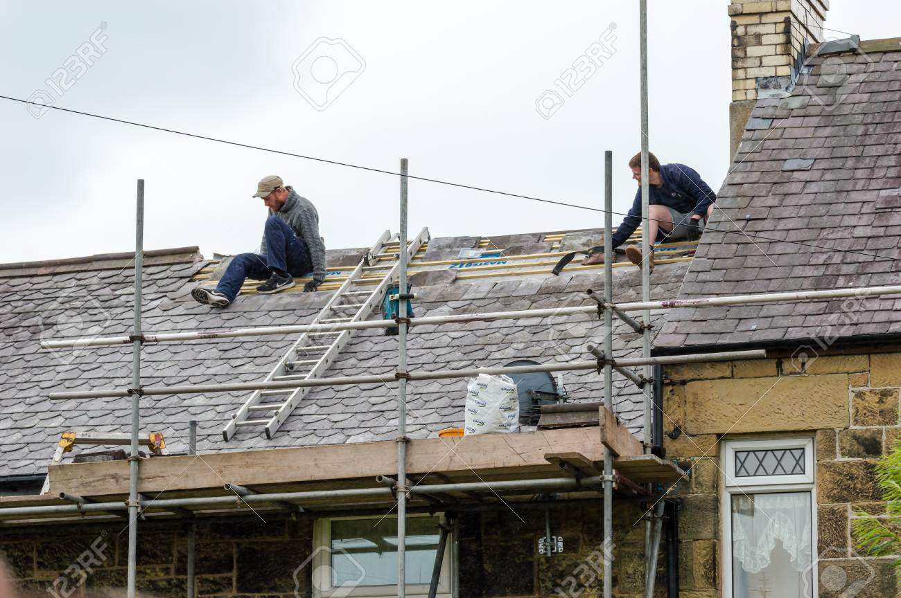 stock photo wrexham wales united kingdom august 11 2016 restoration of decorative slate roof on a residential terraced house in north wales