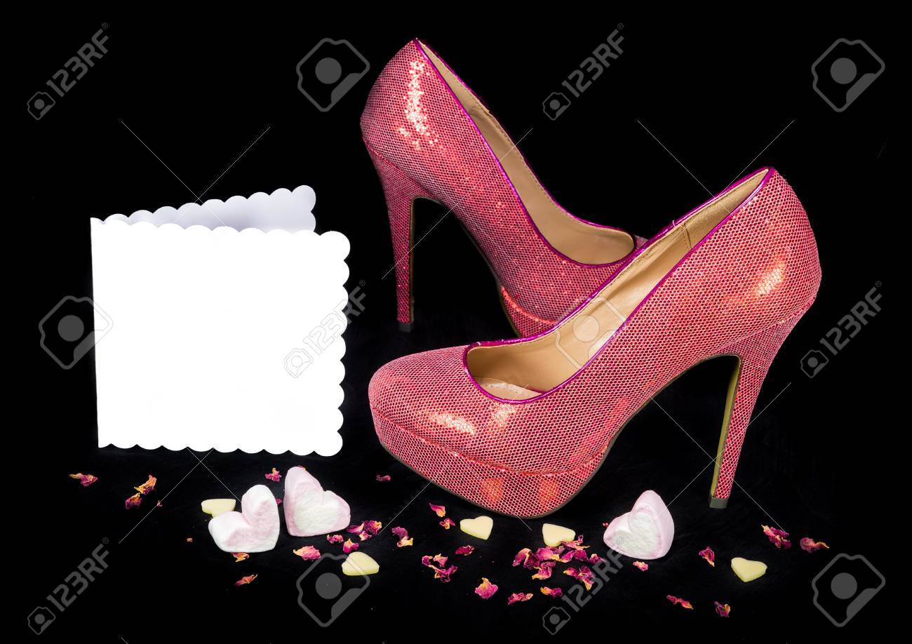 43b10ab8543d Pink high heel party shoes with candy hearts and dried rose petals on a  black background. Love and Saint Valentine s day concept. Blank white  greeting card ...