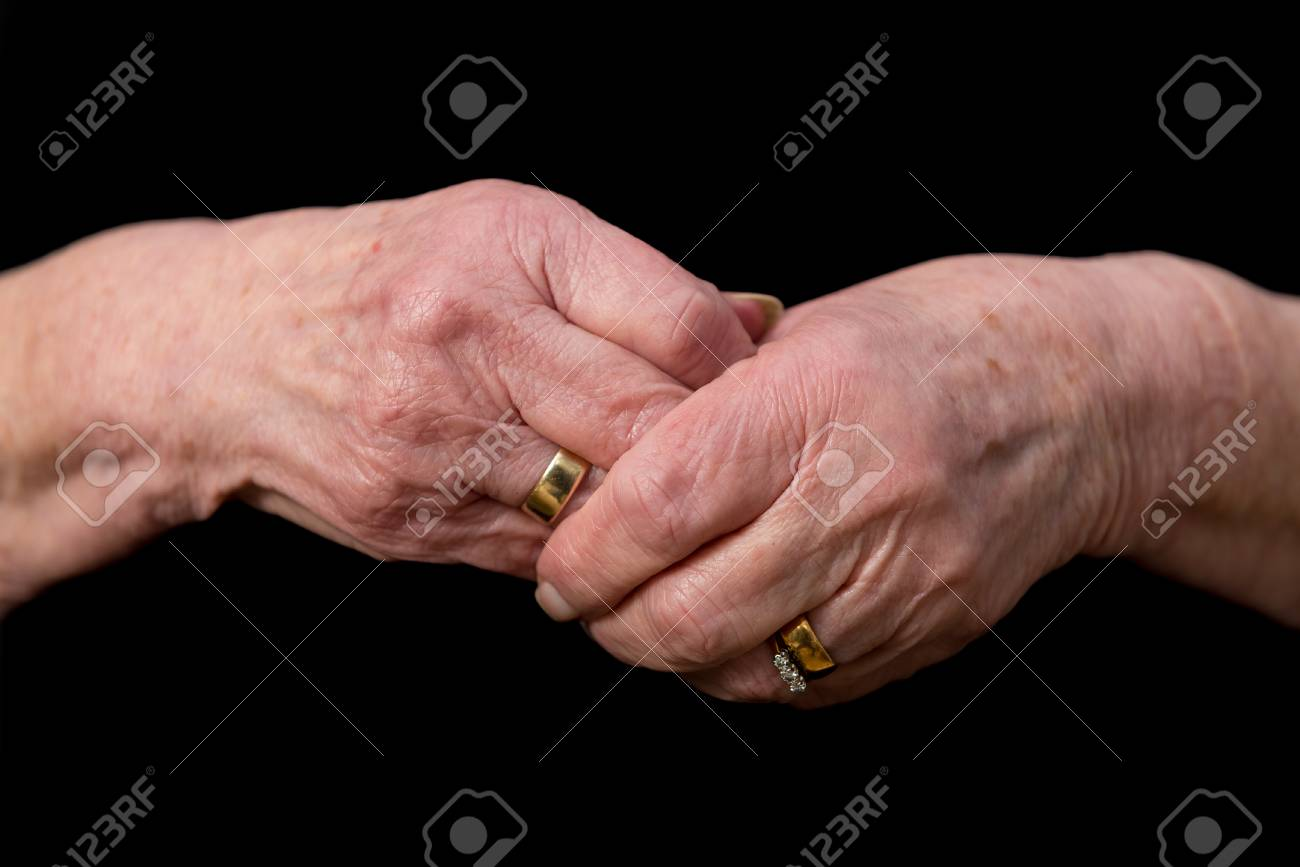 Widows Hands Clasped In Grief Wearing Her Late Husbands Wedding ...