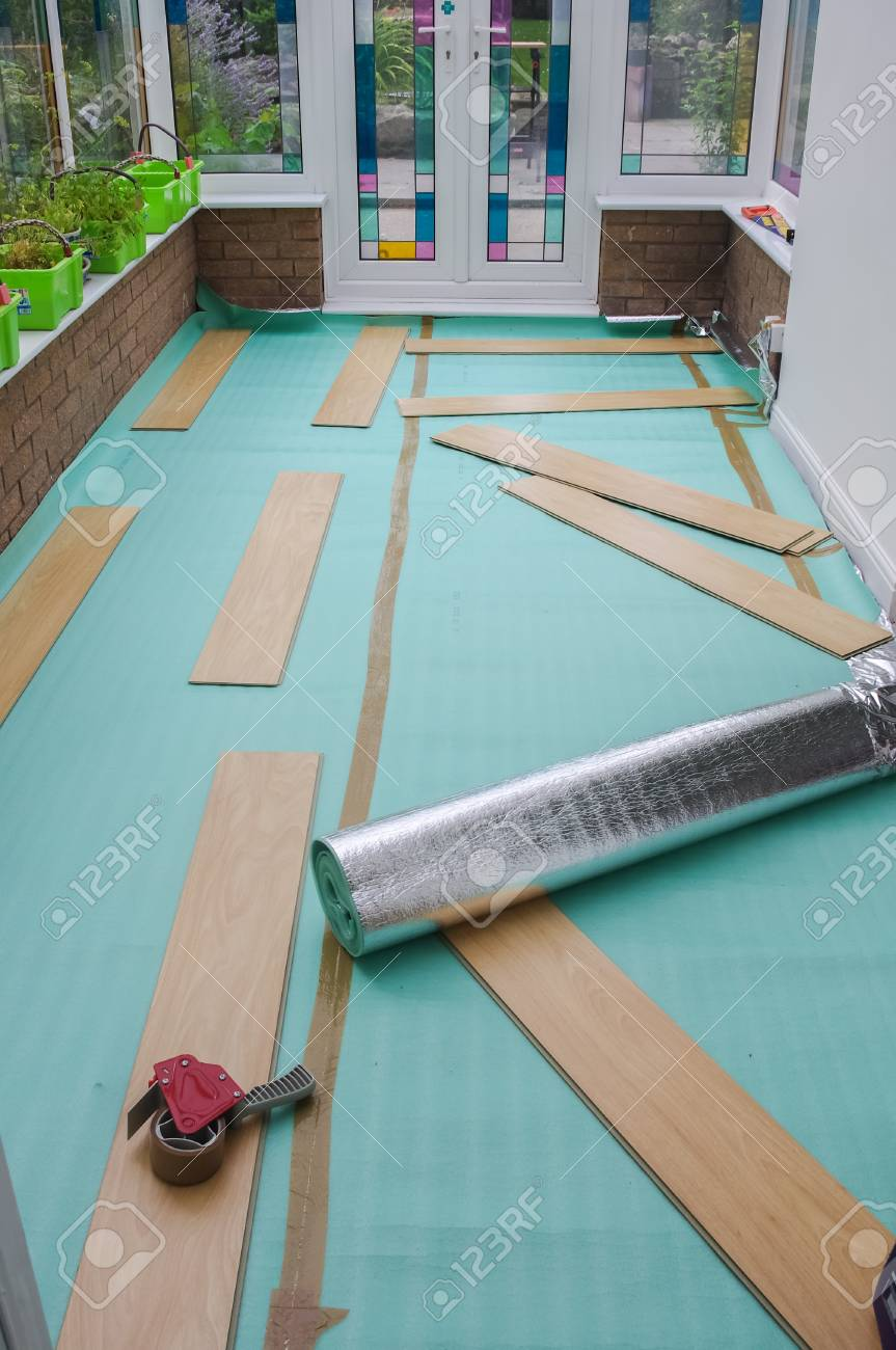 Laying Laminate Flooring Insulated Underlay On Floor Ready For