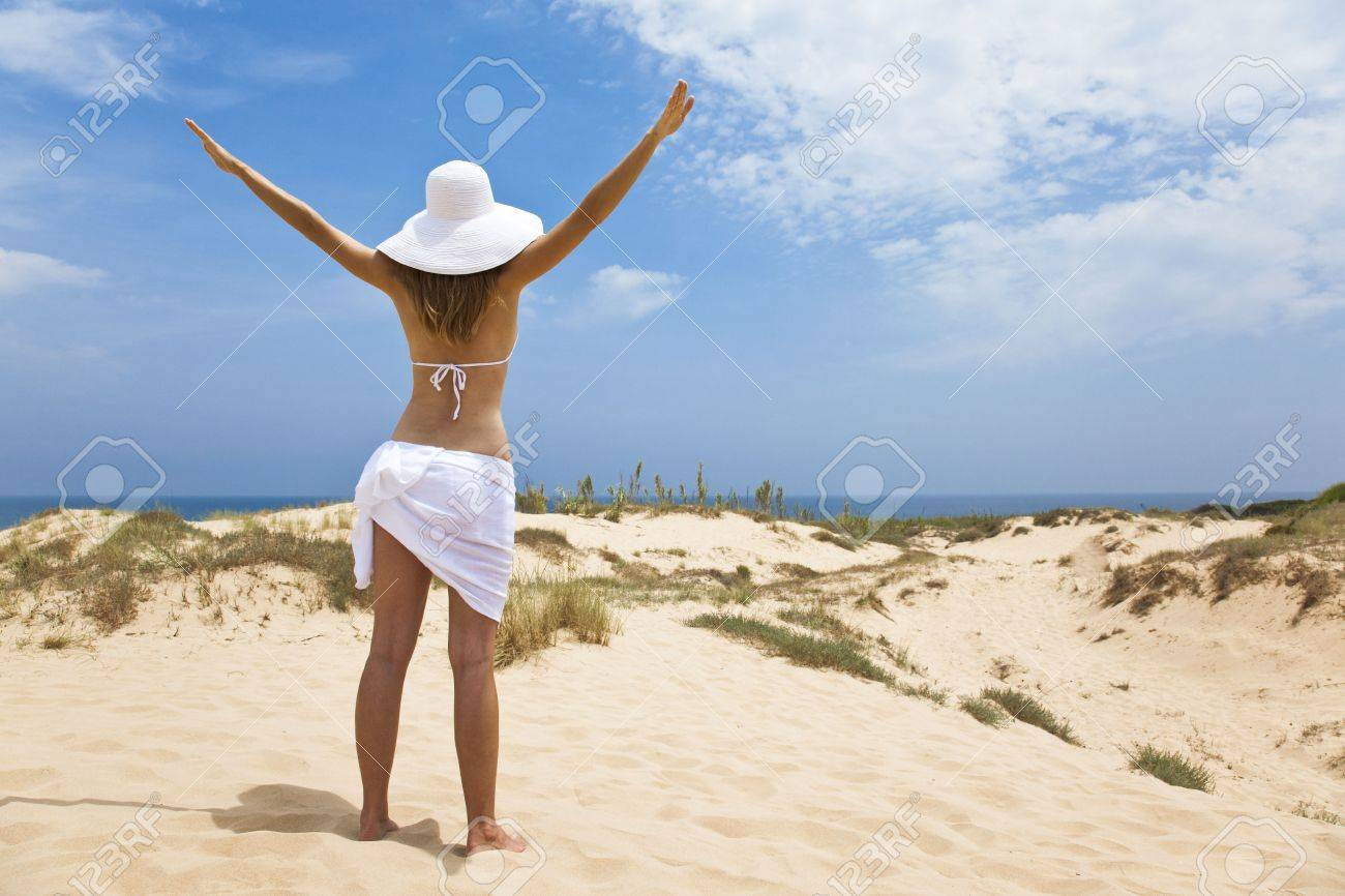 girl in white by the ocean Stock Photo - 5041055