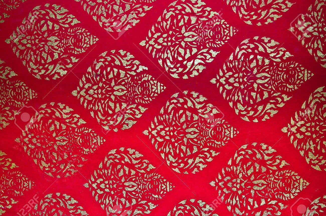 The Traditional Thai Style Art Golden Painting Pattern On Red