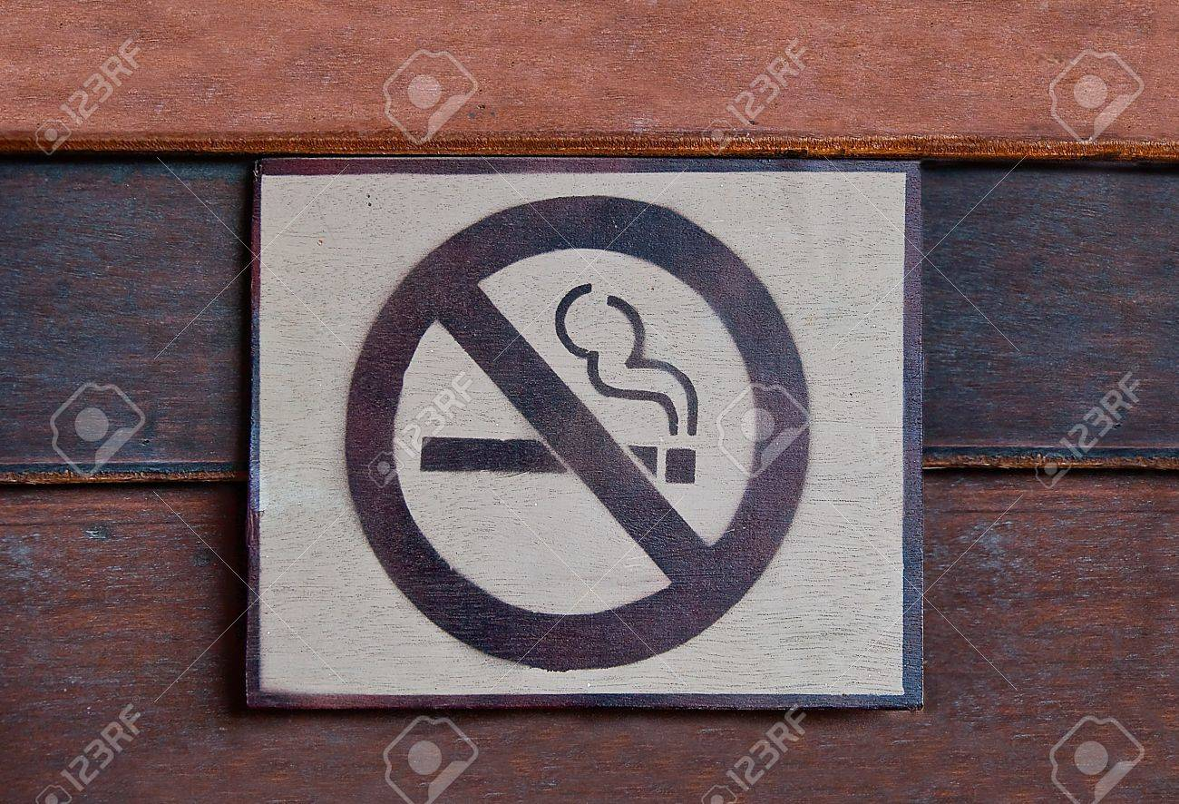 The Sign of no smoking  on wood background Stock Photo - 14178792