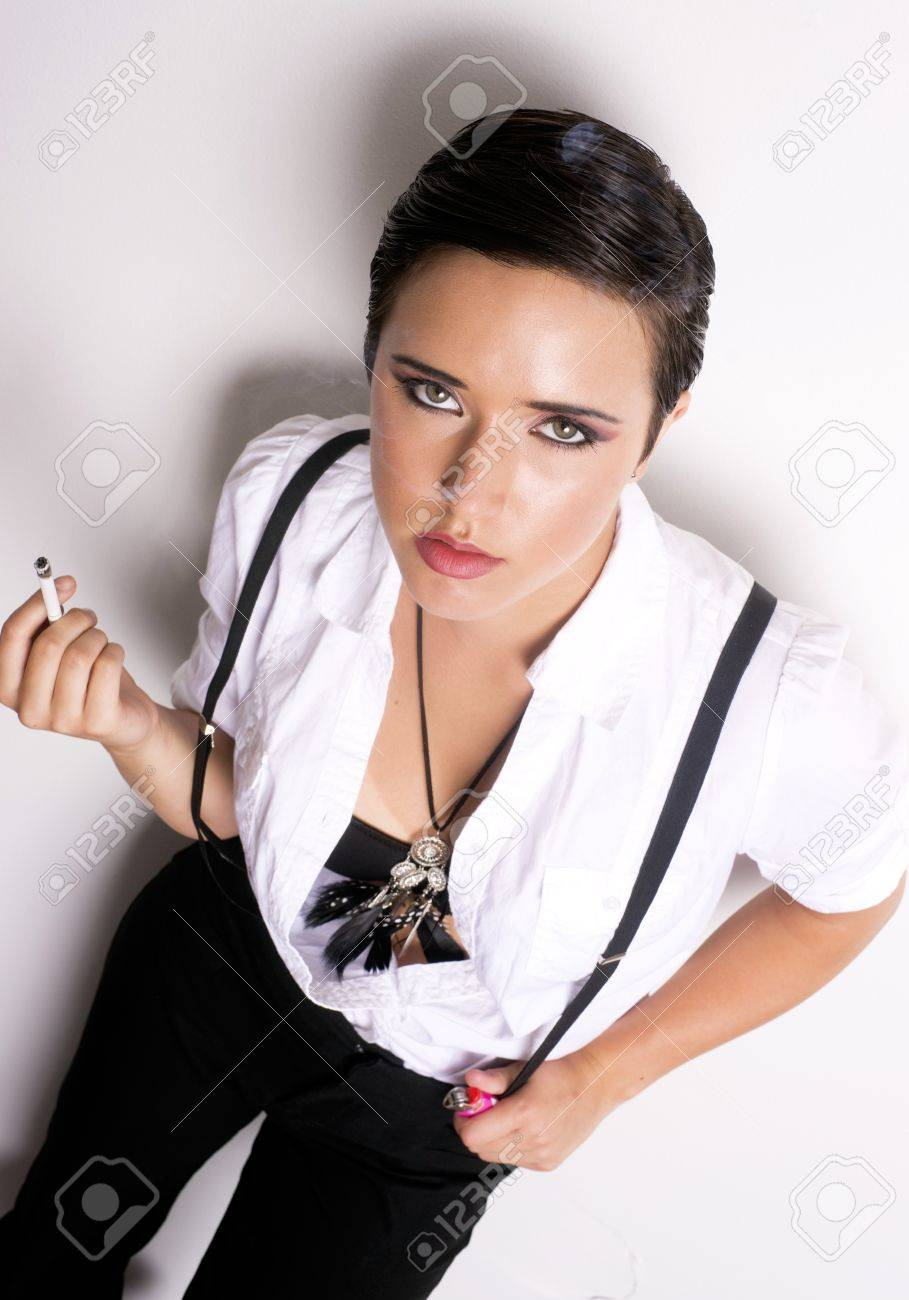 An androgynous person smokes a cigarette Stock Photo - 14499267