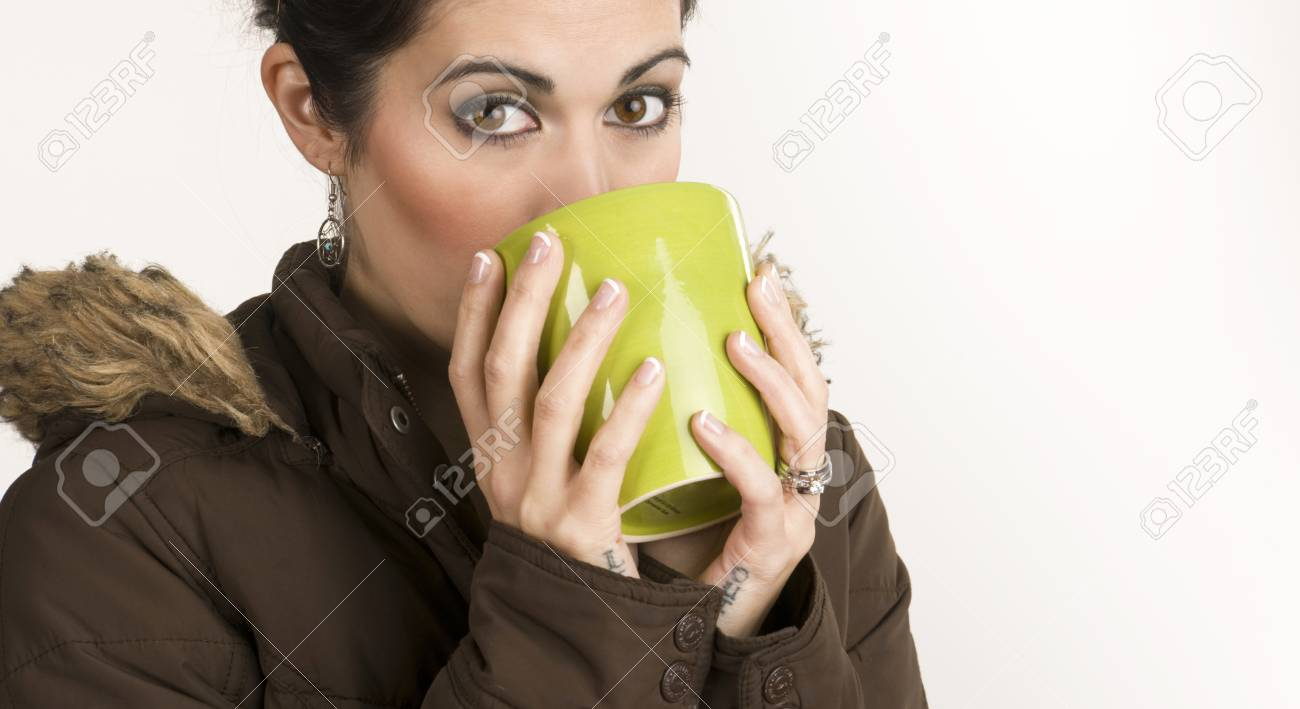 A beautiful woman warms up with a mug of Java Stock Photo - 14669506