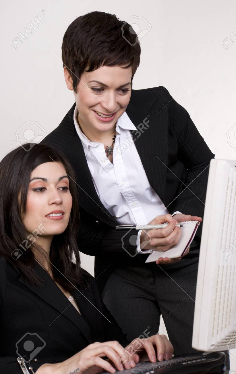 A woman and her supervisor at work Stock Photo - 14669290