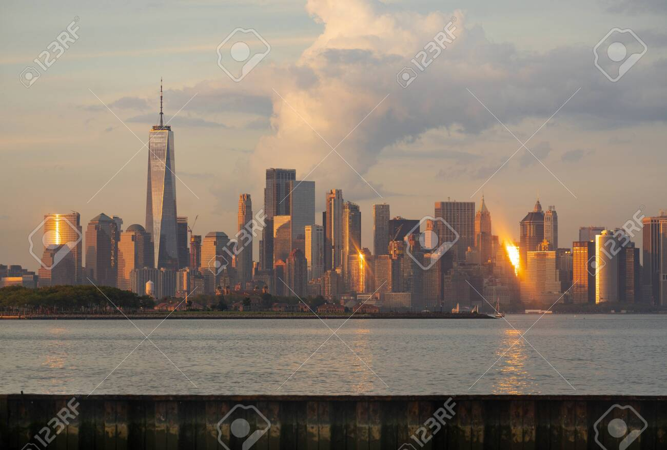 Manhattan is one of 5 Burroughs that make up New York City shown here at sunset - 126958550