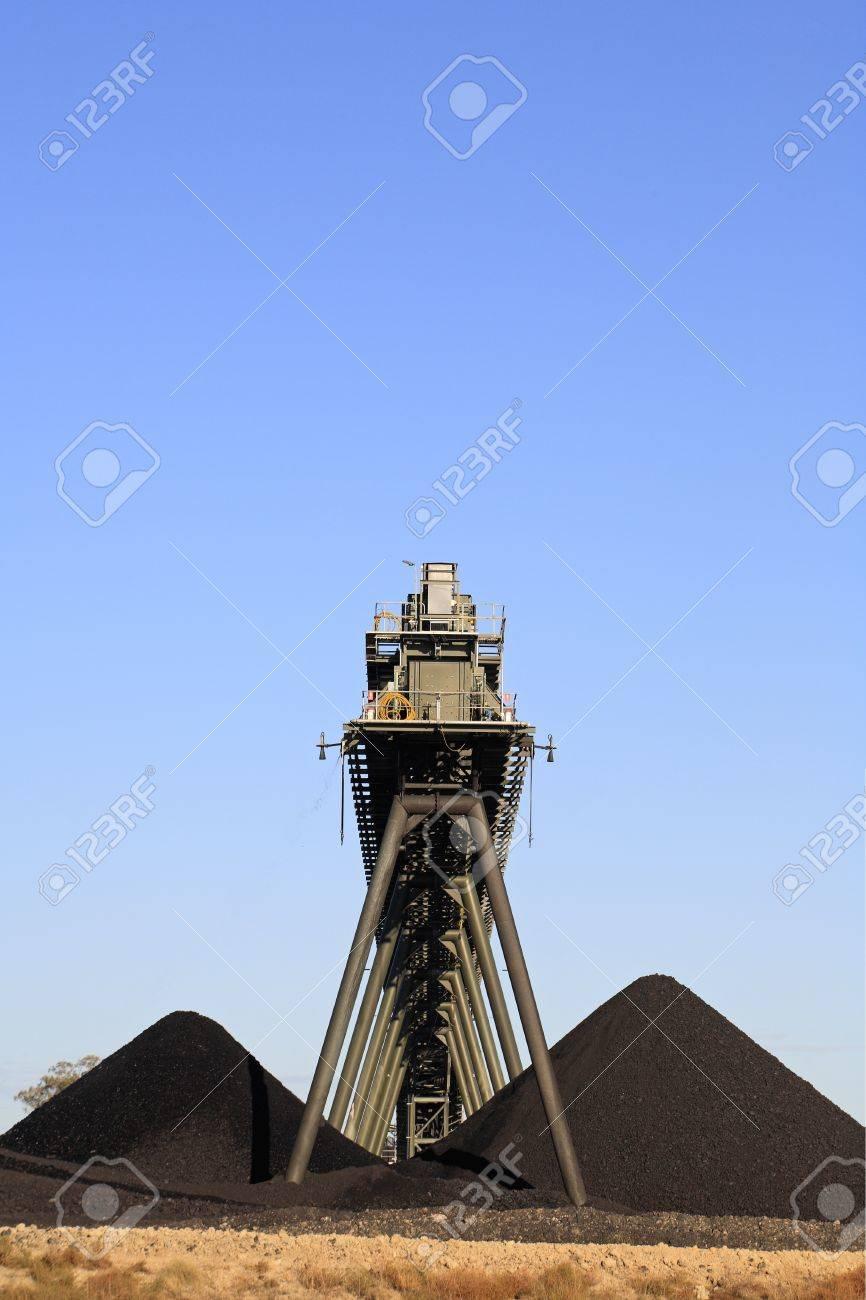 Coal Mining Conveyor Belt and piles of coal with a blue sky background. Australia Stock Photo - 17072010