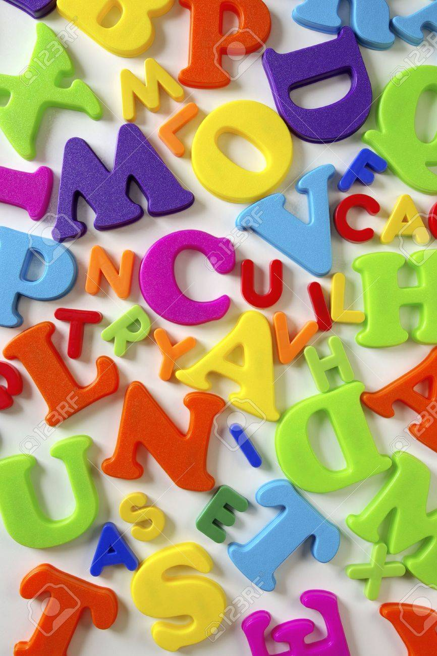Composition of many colorful plastic toy letters over white background Stock Photo - 2427058