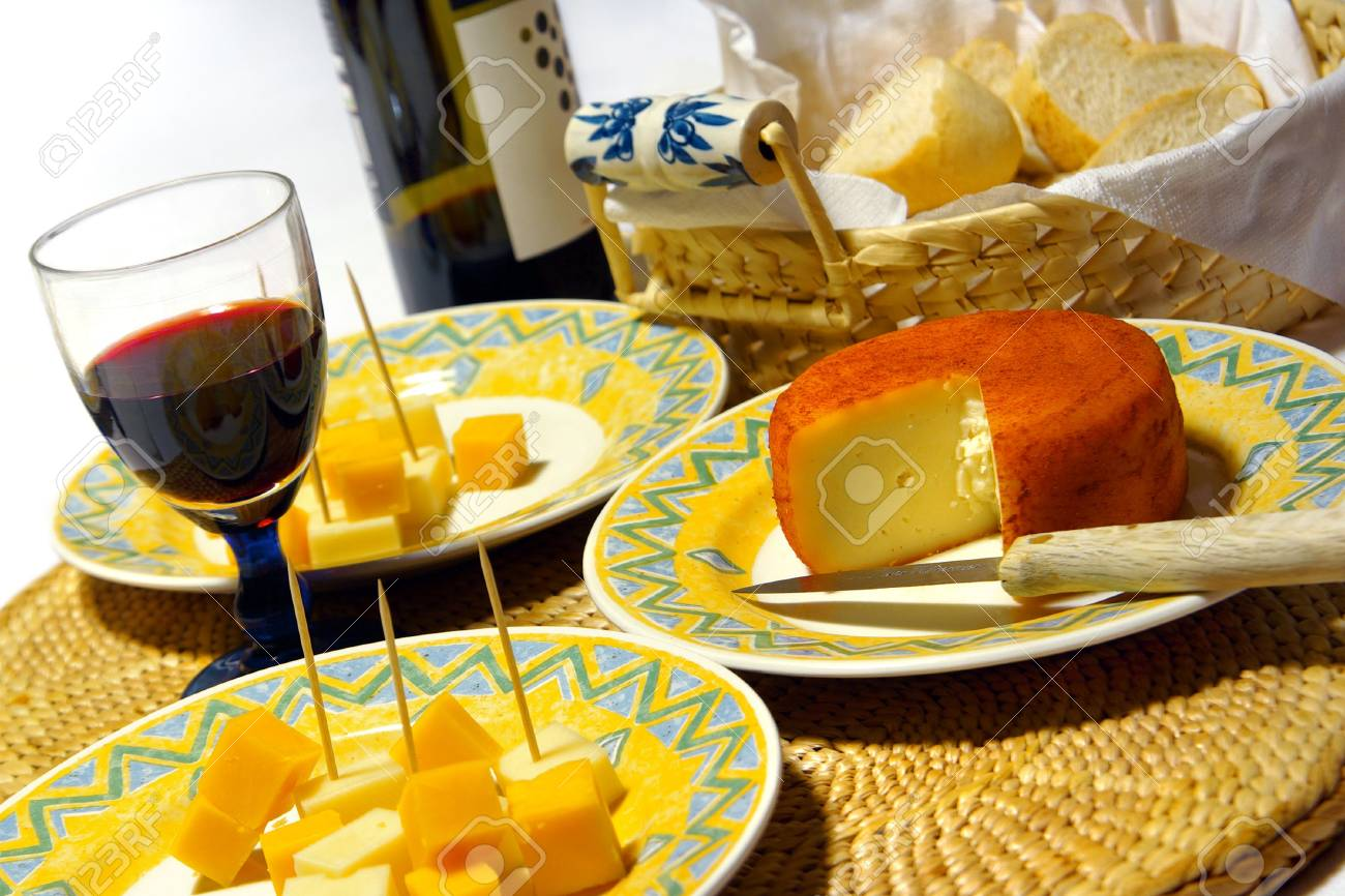 Glass of red wine and assorted cheeses for wine tasting Stock Photo - 3146938