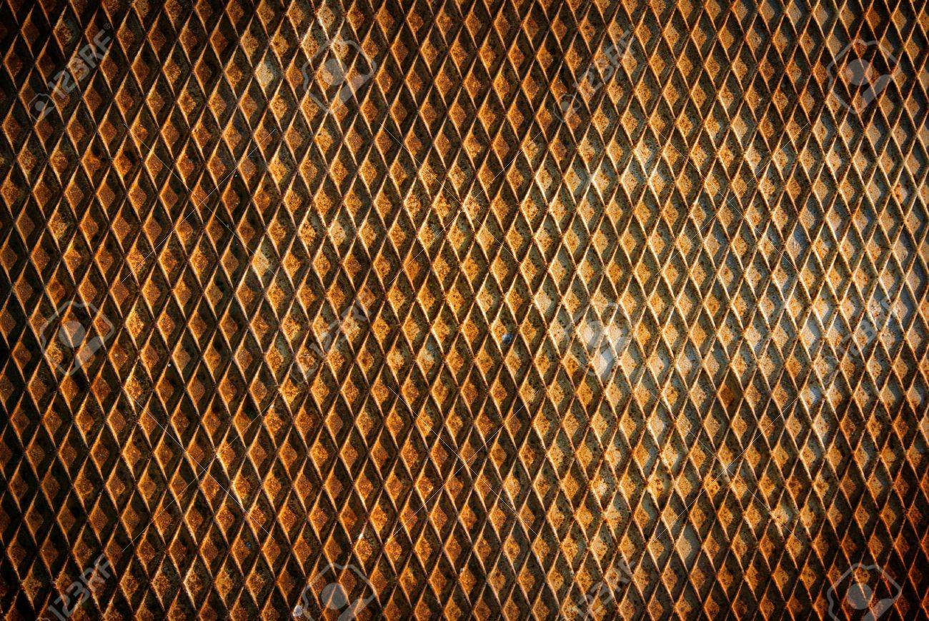 Background of a bumpy and rusty old iron surface with a pattern Stock Photo - 4526972