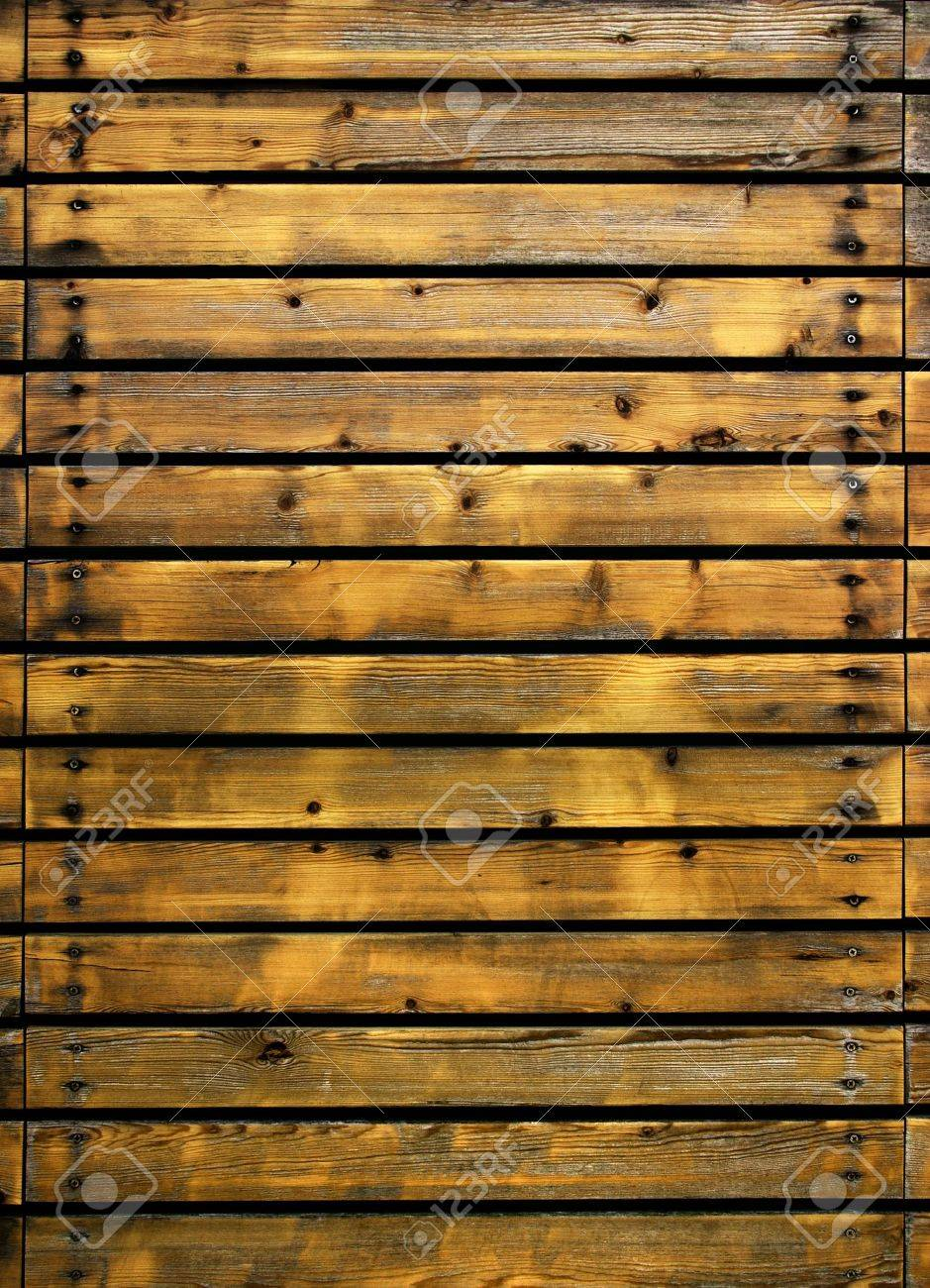 Section of an old fence with wooden planks and nails Stock Photo - 4829858
