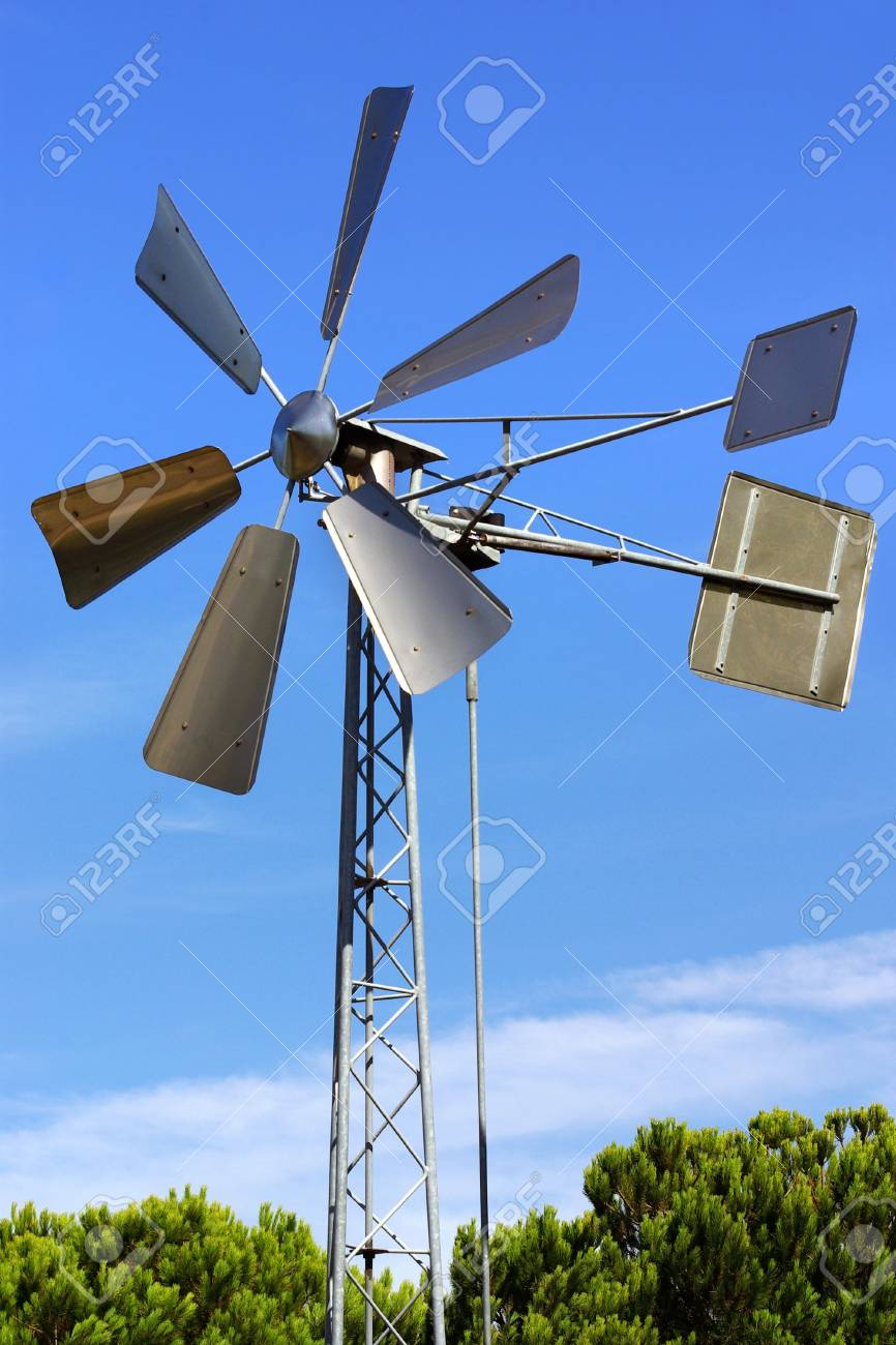 Vintage metallic windmill against blue sky Stock Photo - 5778876