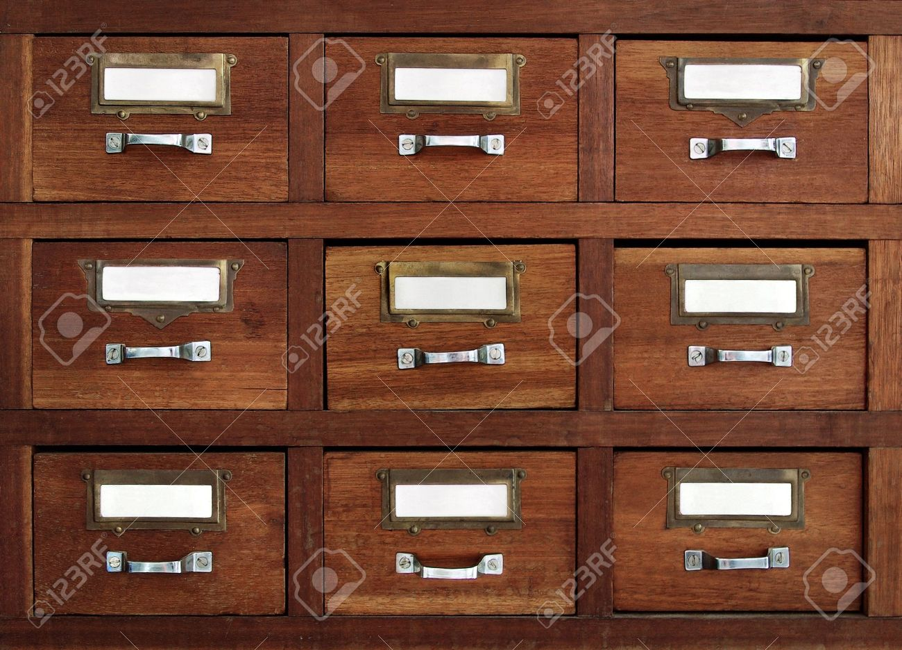Rows of little drawers with white empty tags in an old furniture module Stock Photo - 7014336