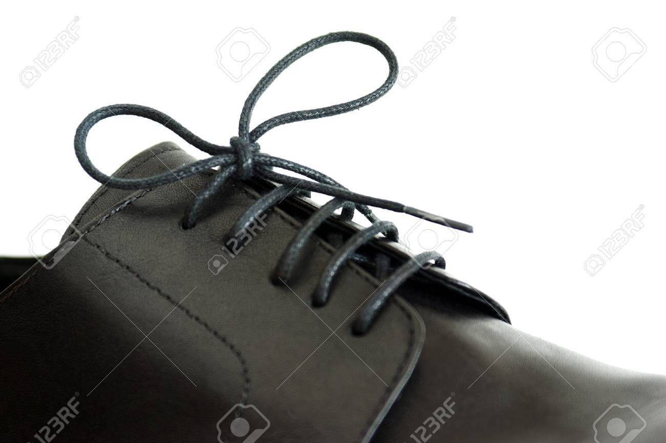 Close-up on a shoe-lace of a male's black shoe Stock Photo - 7319973