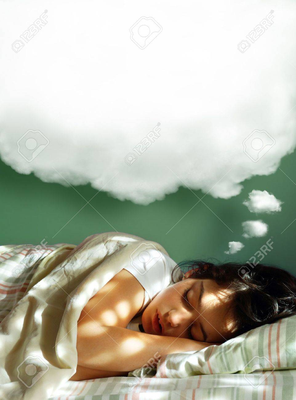 Young girl sleeping in her bed, with a dreaming fluffy balloon above her head Stock Photo - 9577375