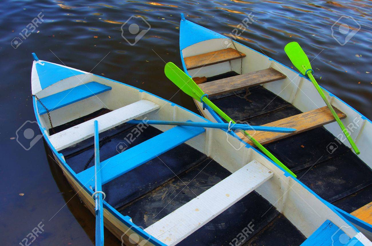 Two blue row boats anchored in a river shore Stock Photo - 10302069