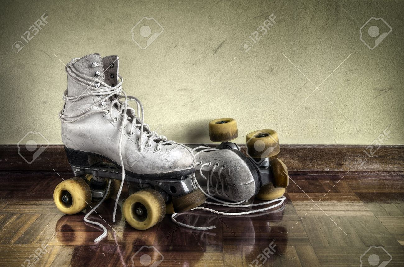 Roller skates vintage - Stock Photo Vintage Roller Skates With Big Shoe Laces On A Yellow Wall Background