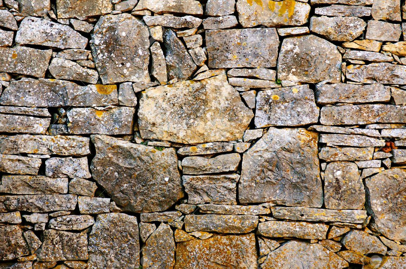 Background Detail Of A Old Rustic Stone Wall Stock Photo