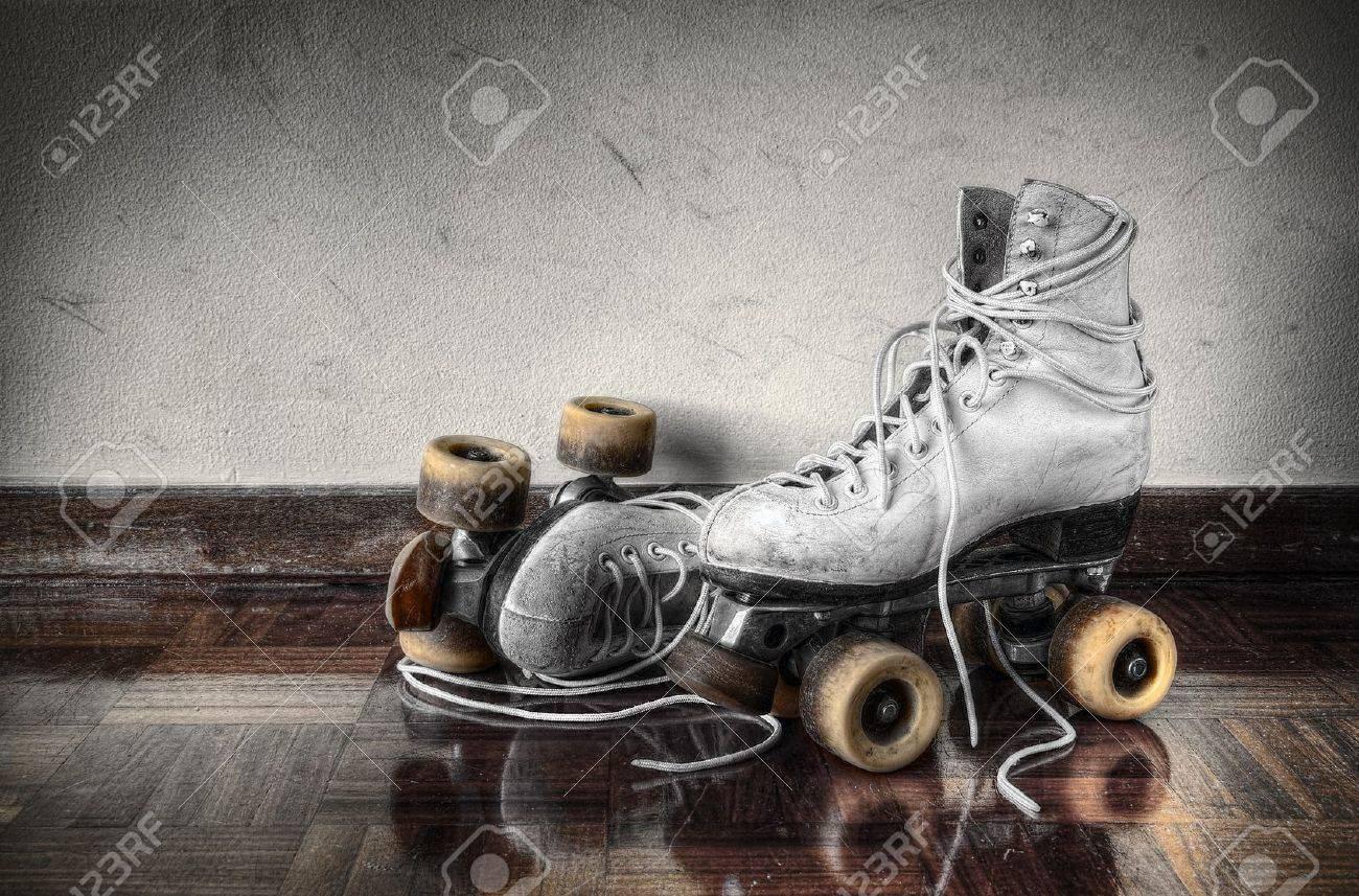 Roller skates vintage - Stock Photo Vintage Roller Skates With Big Shoe Laces On A Dirty Wall Background