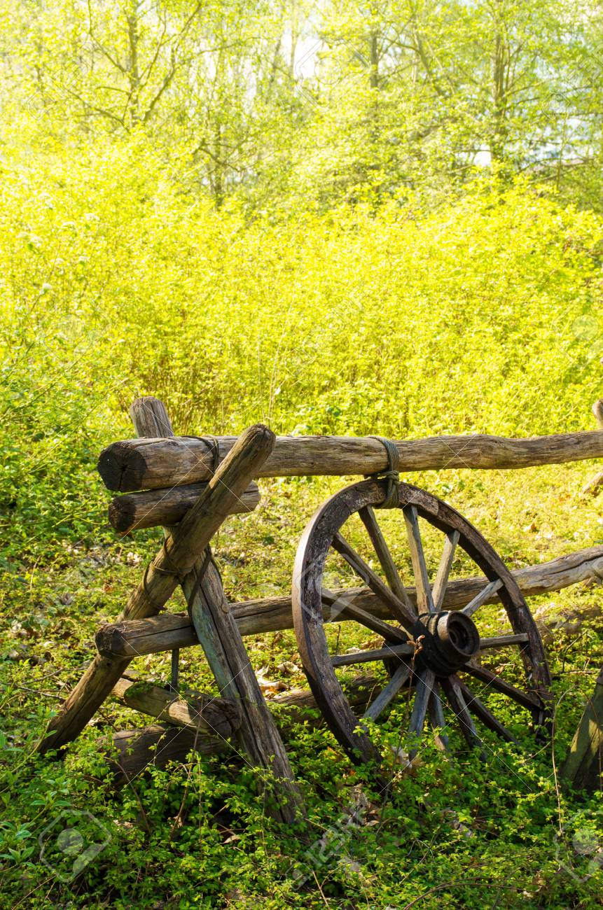 Old Wagon Wheel Next To A Wooden Fence In The Countryside Stock Photo Picture And Royalty Free Image Image 29460826