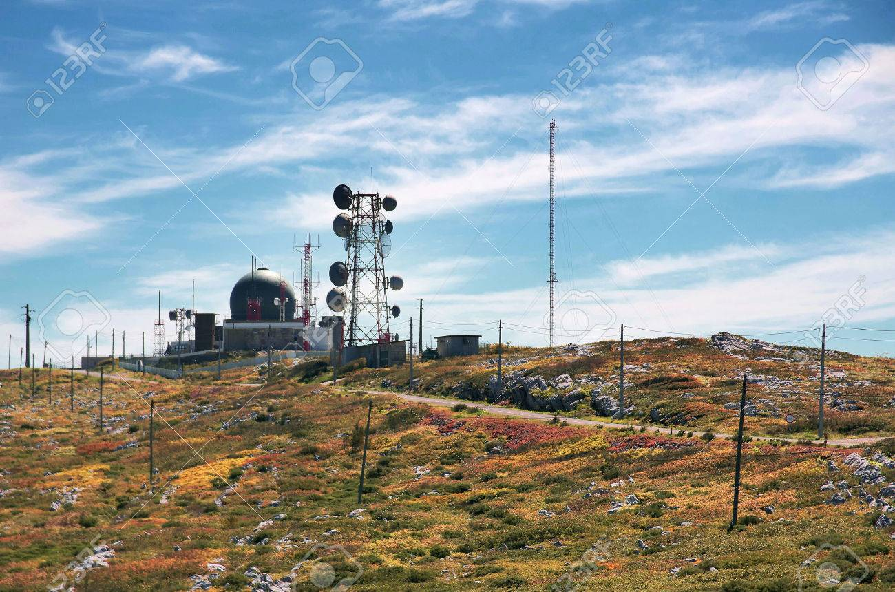 Big wireless communications antennas in a hill under a blue sky Stock Photo - 58414757