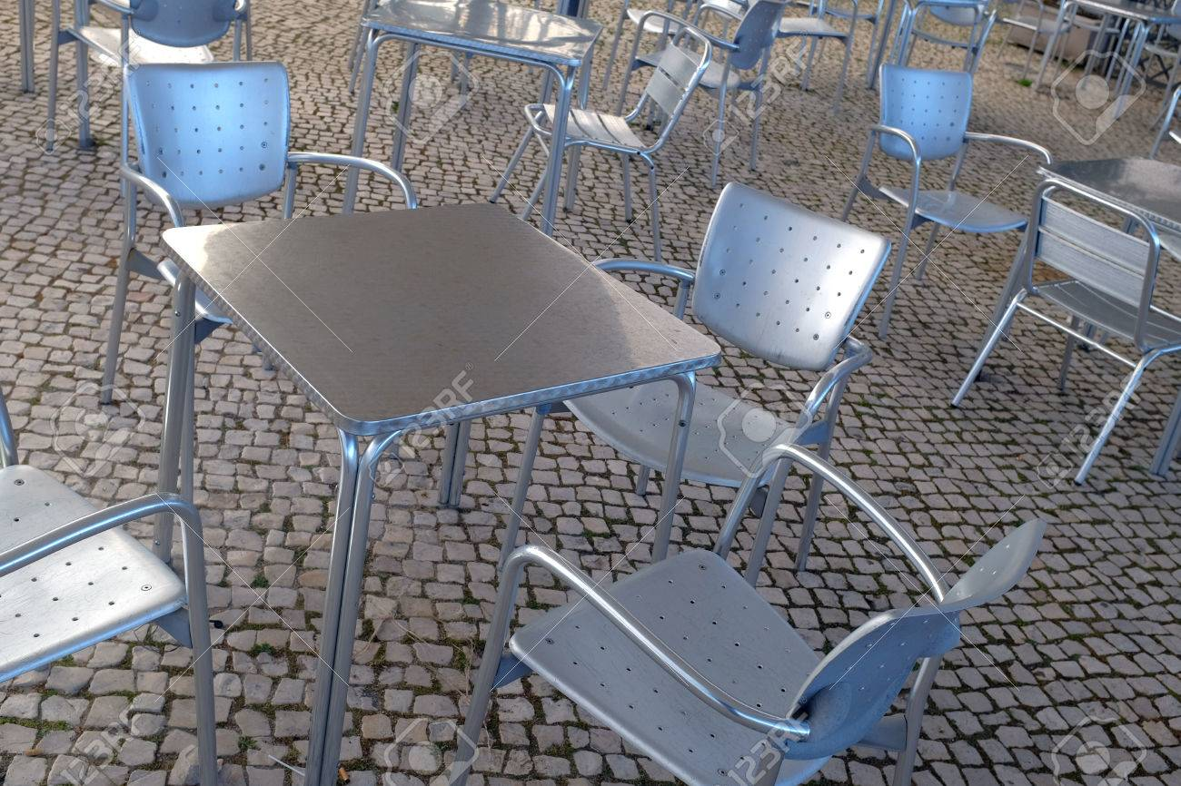 Enjoyable Empty Modern Silver Chairs And Tables In A Terrace Machost Co Dining Chair Design Ideas Machostcouk