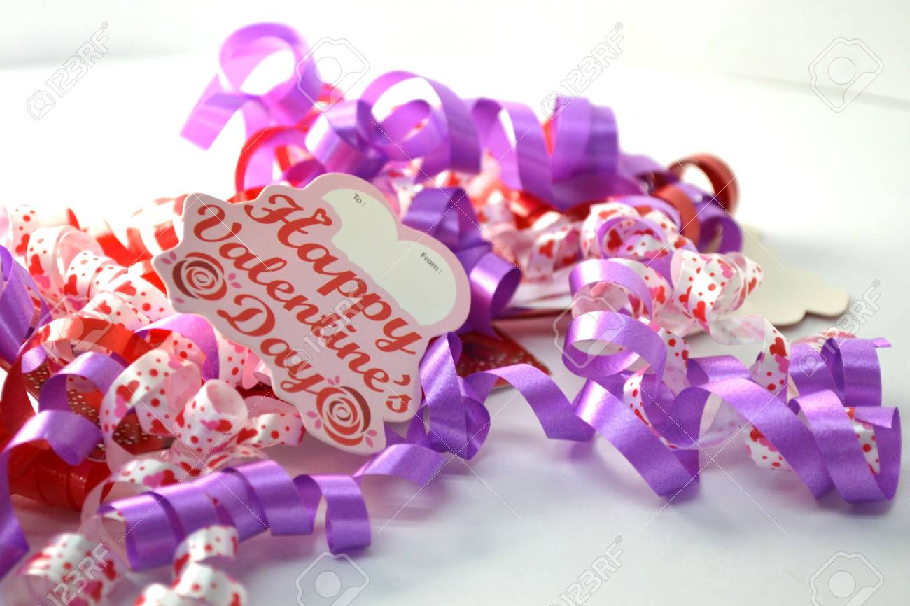 curly celebratory ribbon isolated on white close up; valentines Stock Photo - 11987011