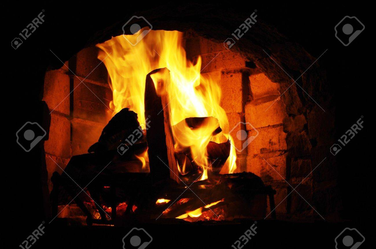Flames in old brick fireplace Stock Photo - 9545537
