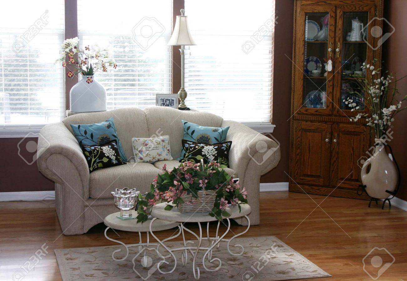 Pretty living room with a china cabinet and white couch