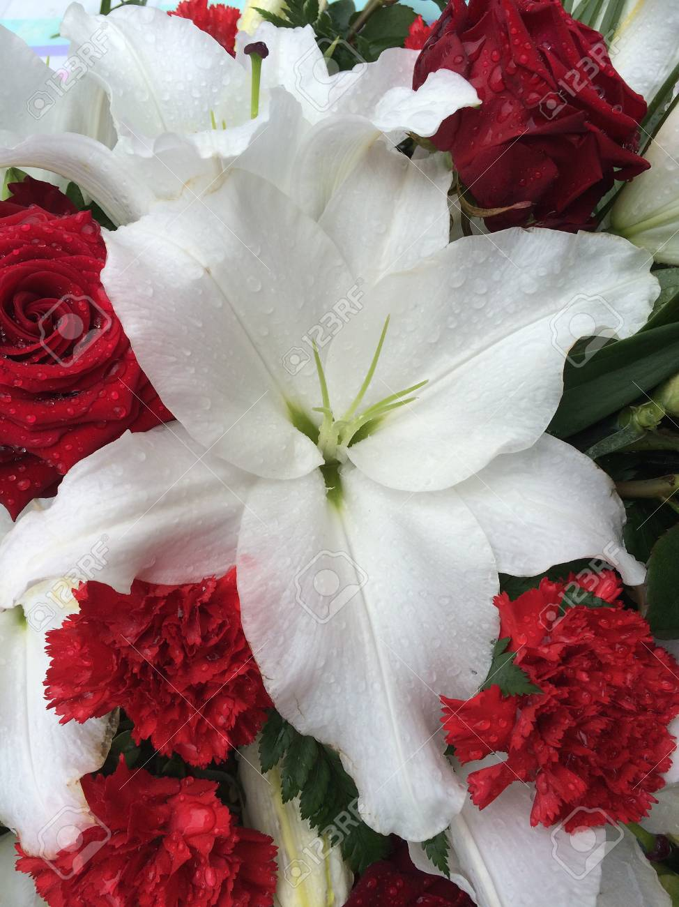 Lilies, Carnations, Roses All In A Bunch. Stock Photo, Picture And ...