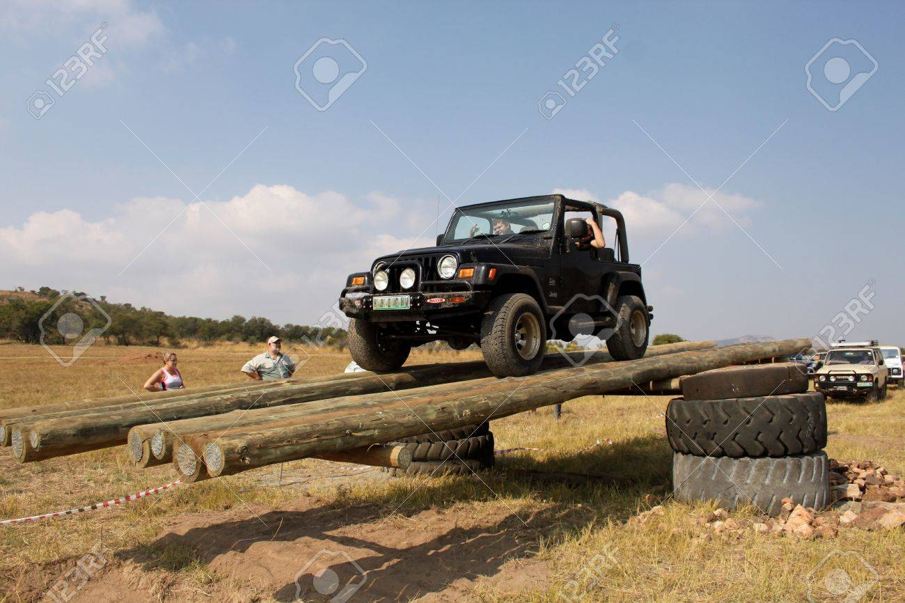 BAFOKENG ? MAY 2013: Black Jeep Wrangler scaling tilt bridge obstacle at new 4x4 track opening event May 18, 2013 at Bafokeng, Rustenburg, South Africa   Stock Photo - 20684193
