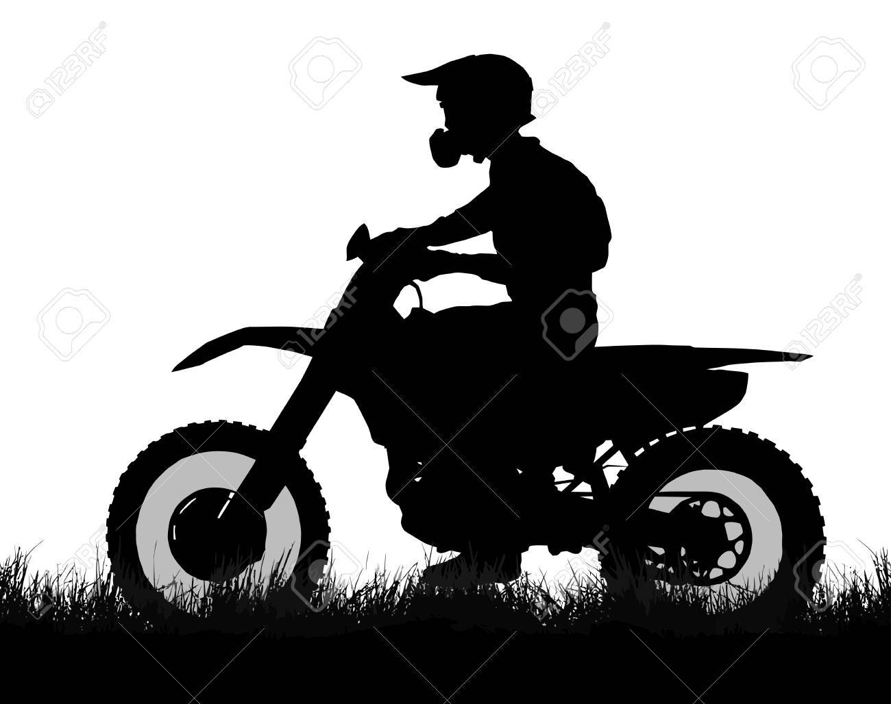 Side Profile Silhouette Of Off Road Biker With Scrambler On Grass