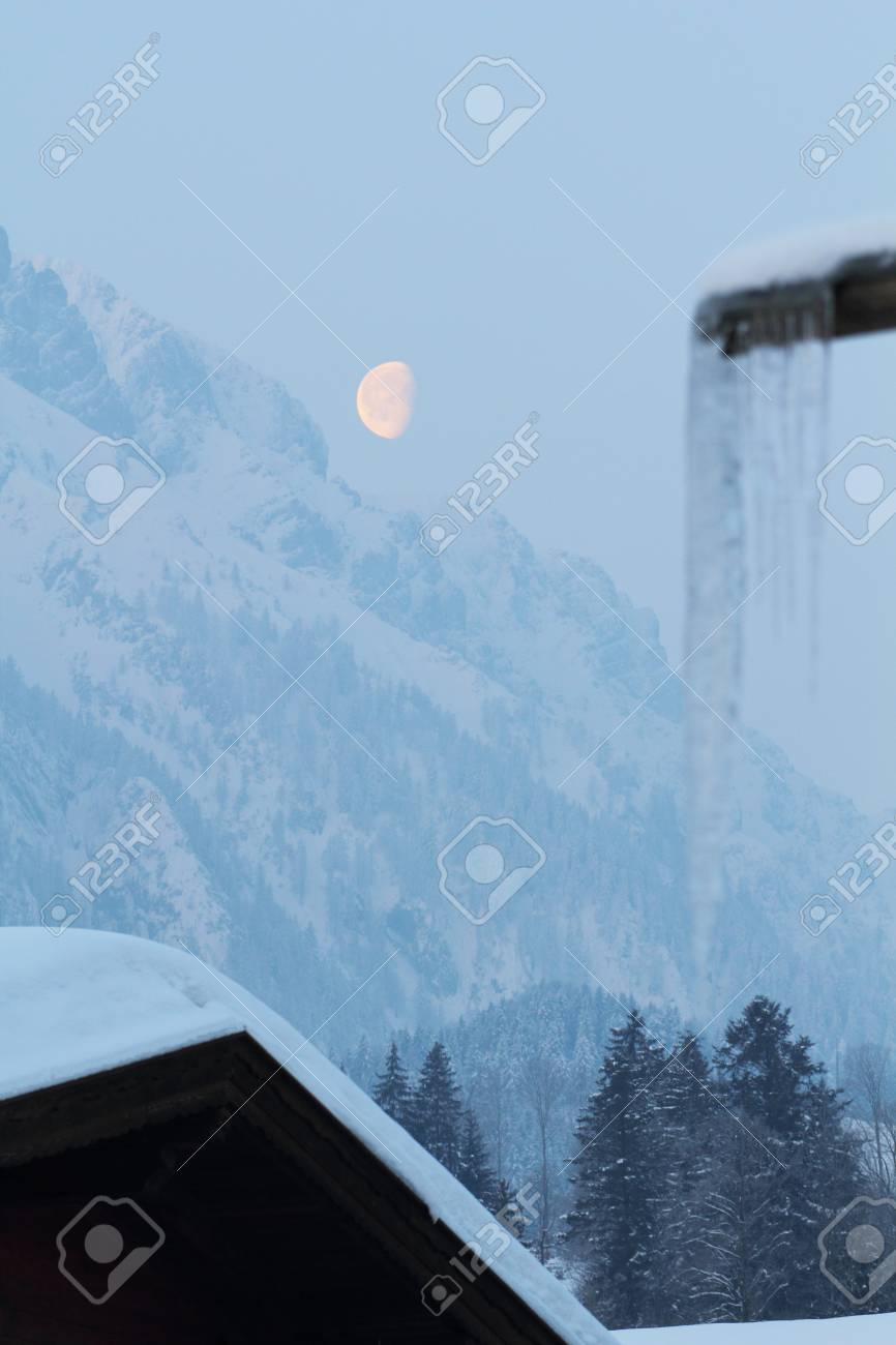 the moon over the austrian mountains in winter Stock Photo - 12448344