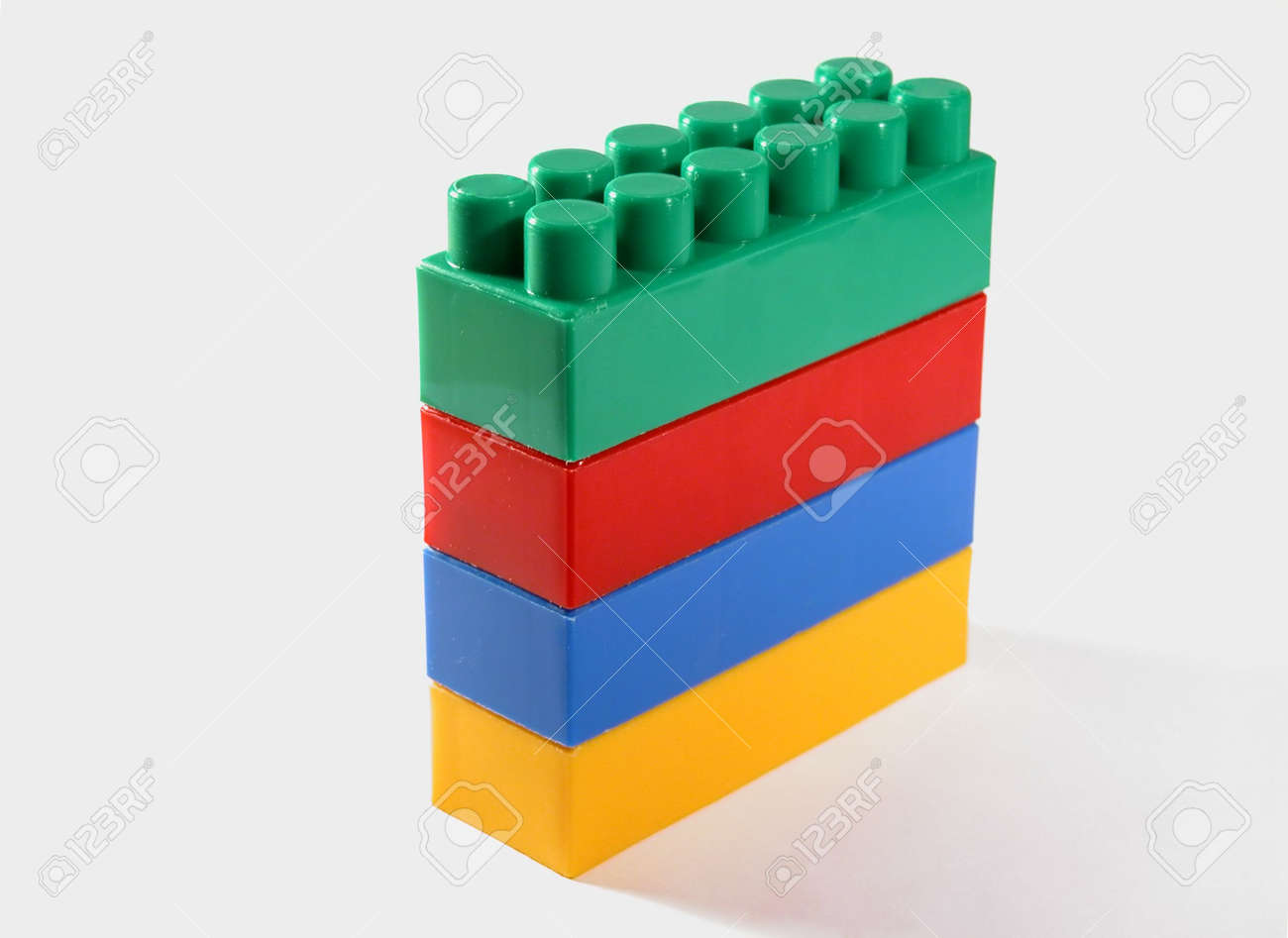 Four plastic toy building blocks standing on each other Stock Photo - 659036