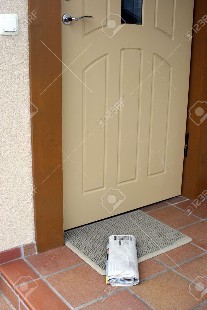 Daily newspaper lying outside by the entrance door Stock Photo - 2320630