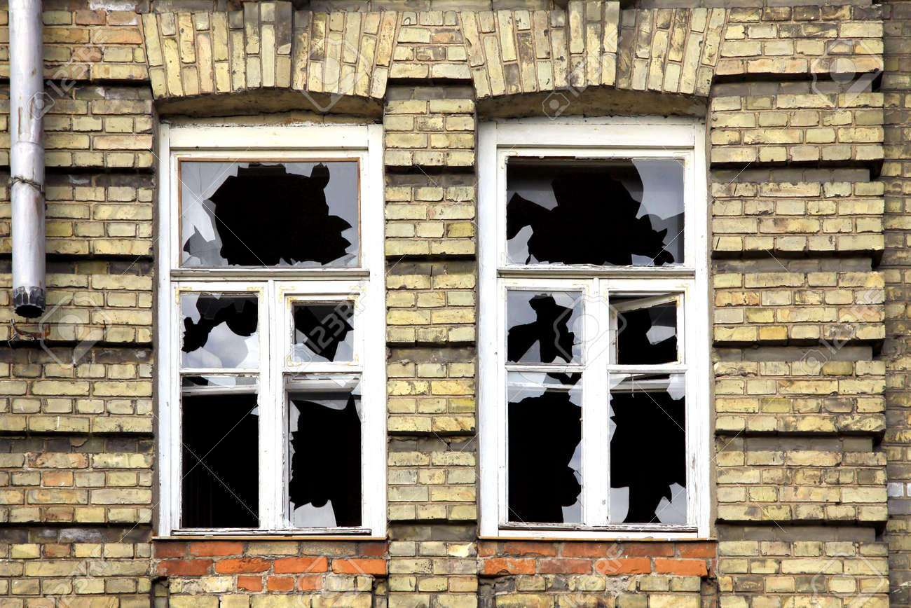 Two broken windows of the old abandoned brick building Stock Photo - 8191871