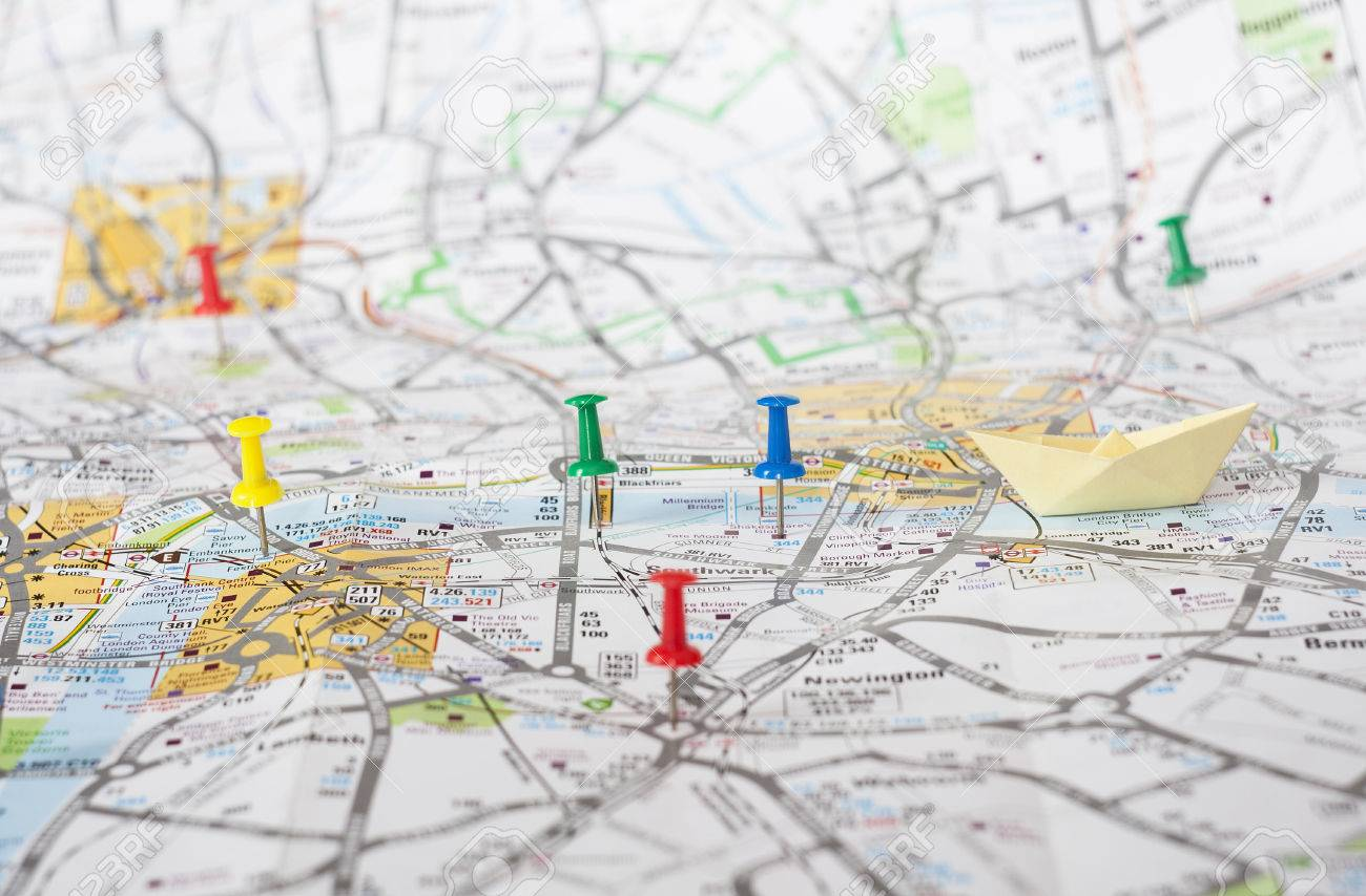 closeup of paper pins on london city map travel concept stock photo