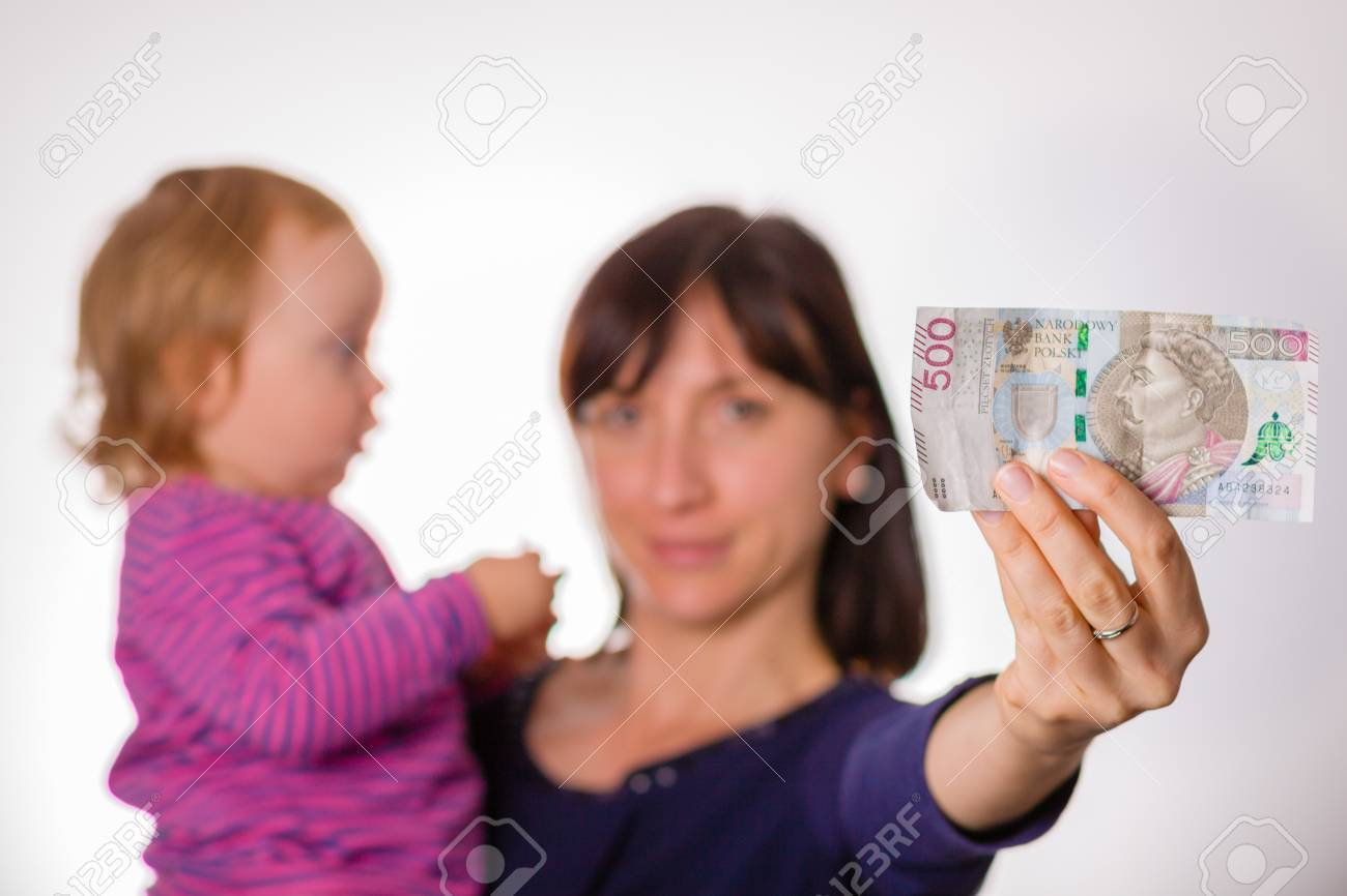 Mother With Little Daughter Holds In Hand 500 Zloty Banknote